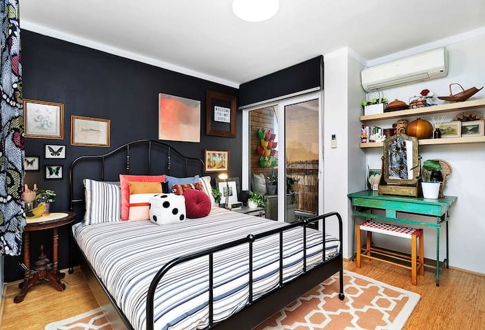 Rest soundly in this eclectic-boho bedroom. You'll want to sleep all day!