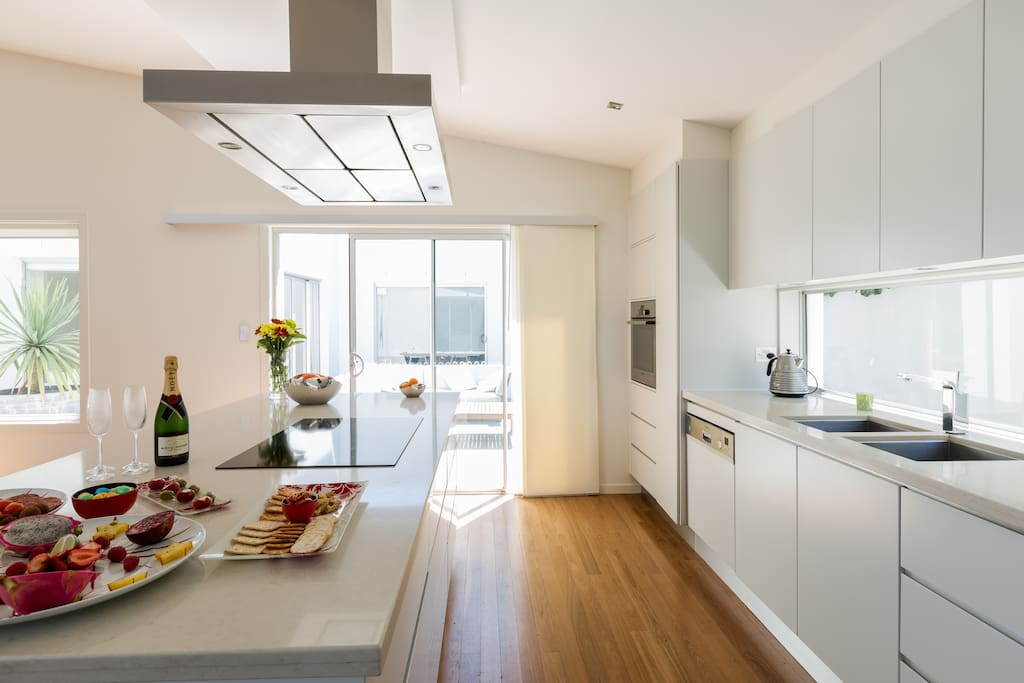 Gourmet designer kitchen. Let  your imagination run riot. The pool and courtyard area are in full view from the kitchen
