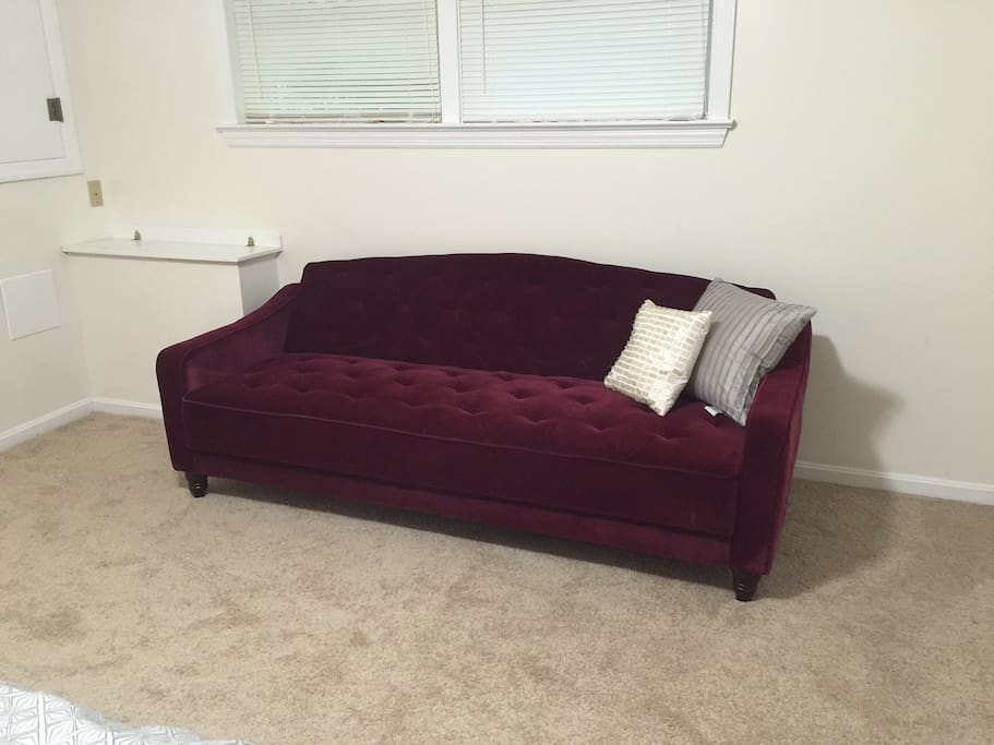 Convertible sofa is great for relaxing or extra guests.