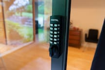 Enter the back door to the room via this key pad lock.