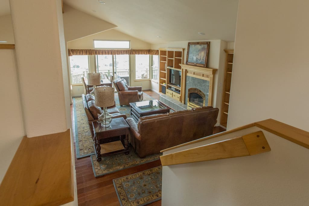 The large open layout is perfect for entertaining friends and family. This inviting living room has comfortable seating, amazing views and fireplace.