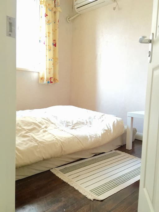This is the guest room, little but cozy. I used to sleep in it myself when my parents visit, so I ensure the mattress is very comfortable!