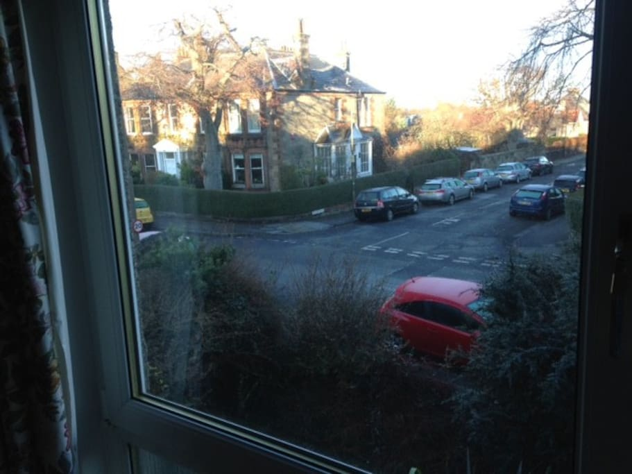 Looking out of the living room window to the end of Netherby Road. Free on street parking on any of these streets around