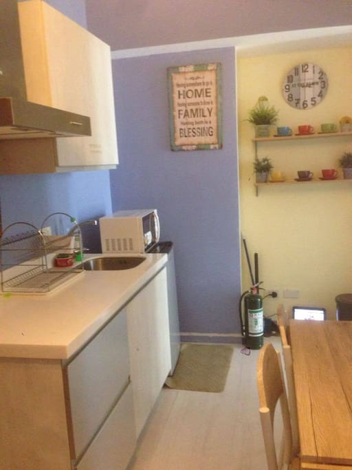 kitchen with microwave, ref, rice cooker and kettle