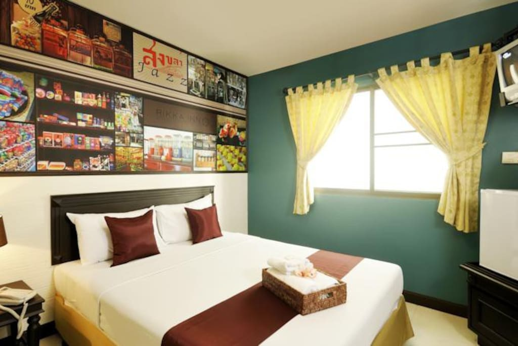 Superior double room 18 sq.m.stylish and spacious room with exquisite decoration. Features of this room include air conditioner, free WiFi Internet, laptop-size safety box, fridge, bathroom amenities, sattelite TV, working desk, hair dryer.