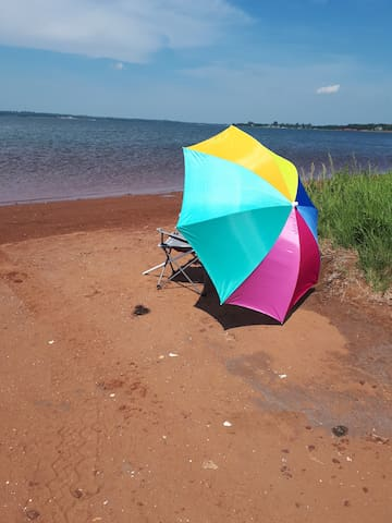 Enjoy the shoreline at the edge of the property.