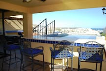 Everyone staying either upstairs or downstairs can enjoy the private pool and bar on the second-level deck.