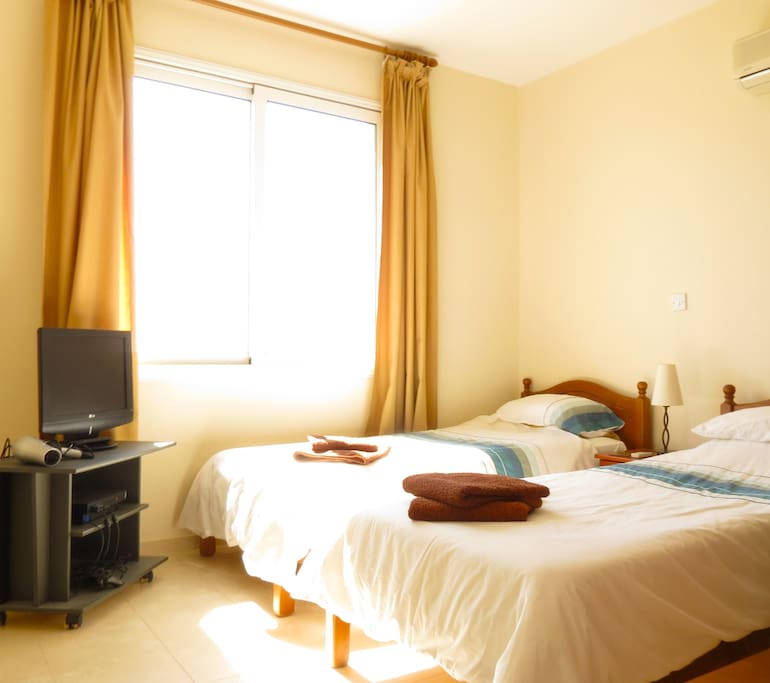 twin bedroom air conditioned and flyscreens on window with TV and Playstation. En-suite bathroom