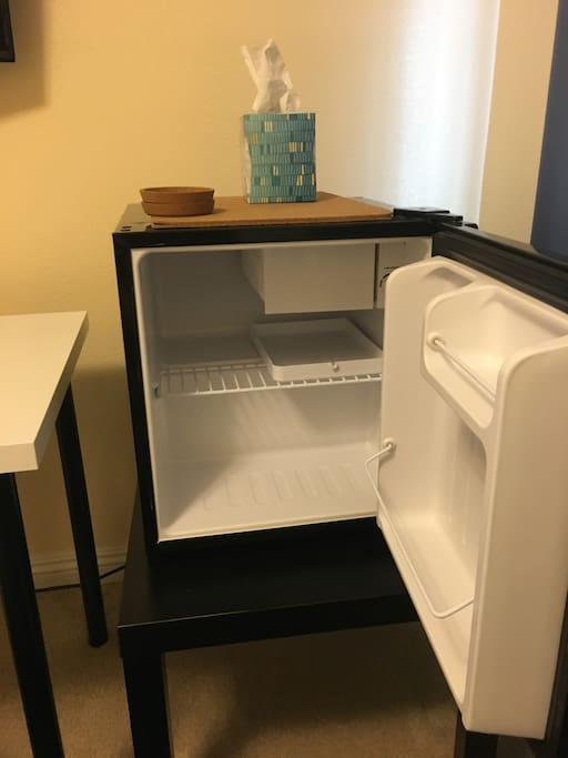 A mini fridge to keep your beverages and food nice and cold on a hot day