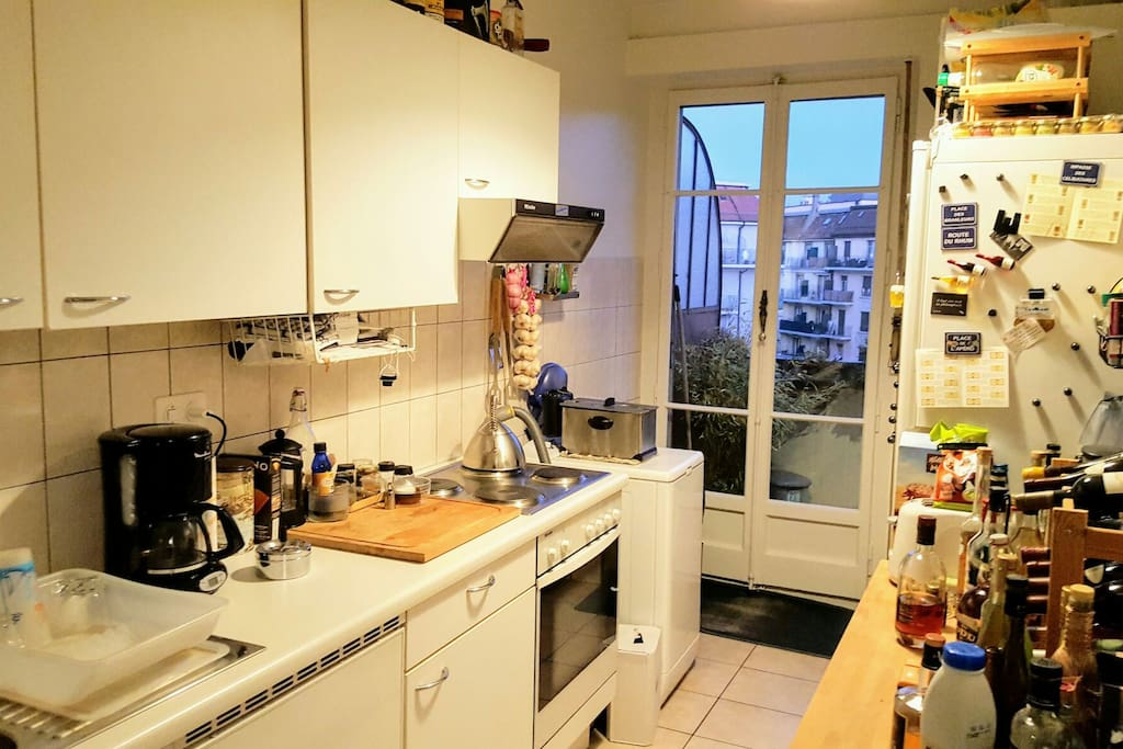 Cozy kitchen with access to the balcony