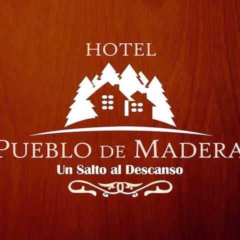 """Hotel Pueblo De Madera """"Un Salto al descanso"""""""