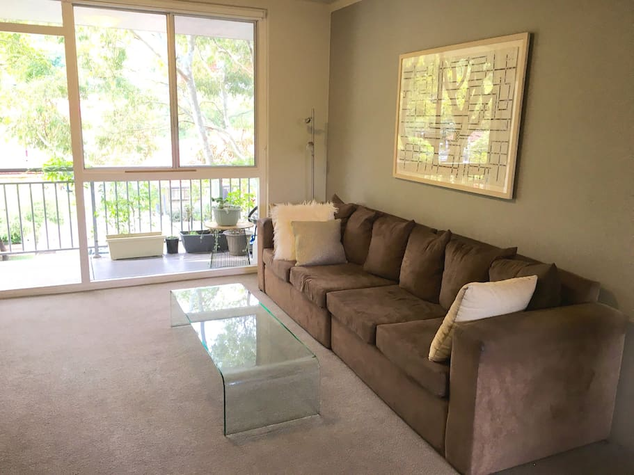 Spacious and sun-drenched lounge room. Super comfortable and cosy.