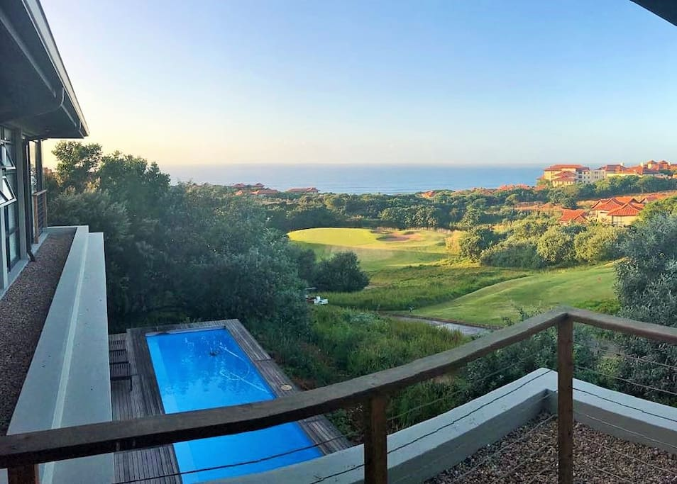 Pool, sea and golf course view