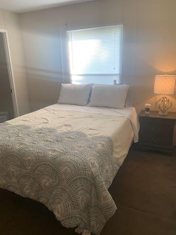 Queen bed with bathroom
