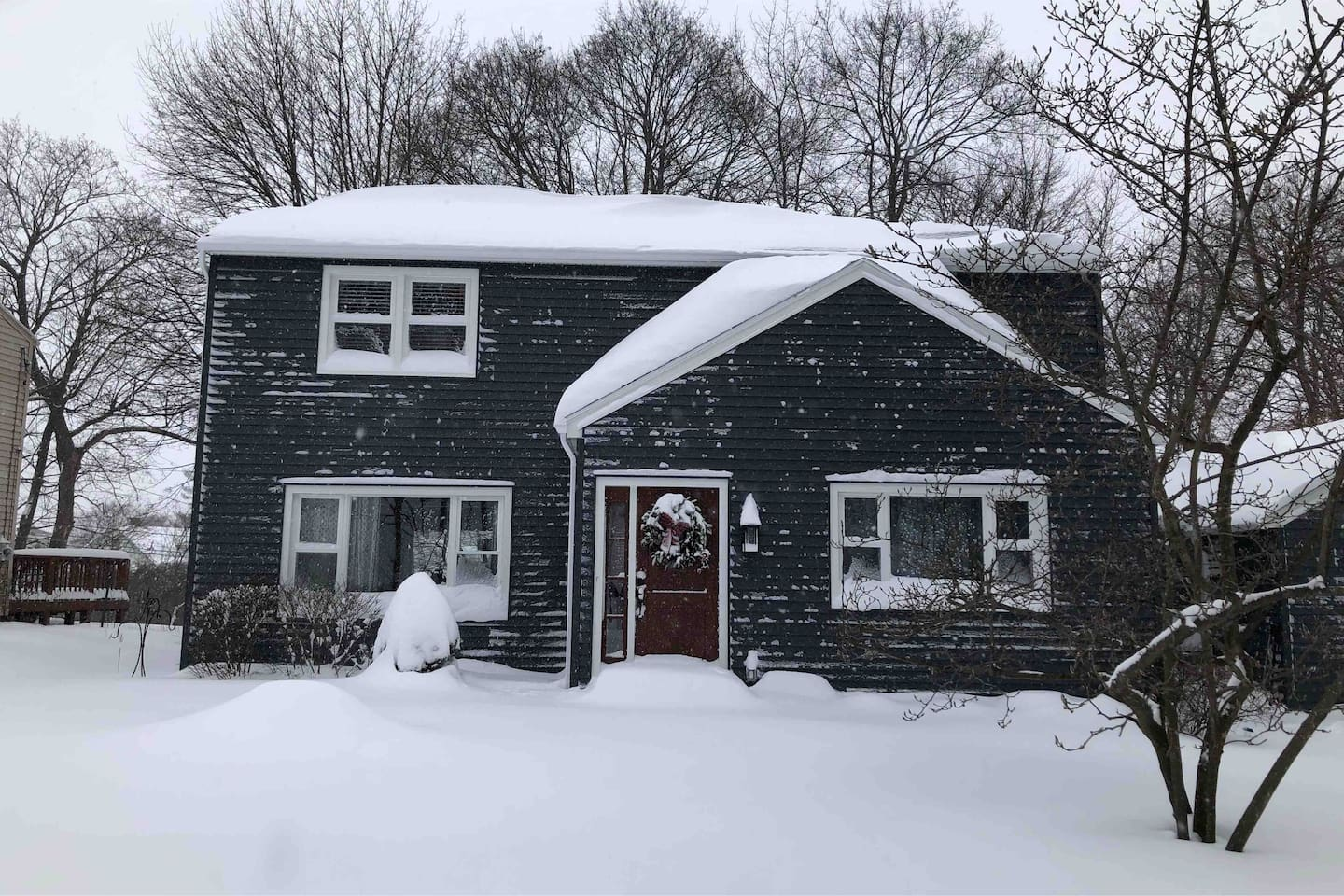 Front of our house covered in snow.