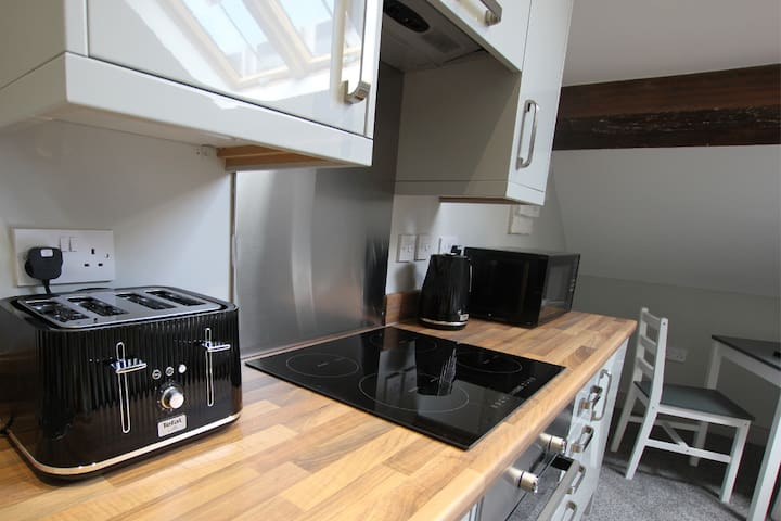 Each apartment comes with a kitchen area, with toaster, microwave, kettle, oven, hob, fridge, cutlery, kitchen utensils, saucepans and complimentary tea, coffee and milk.