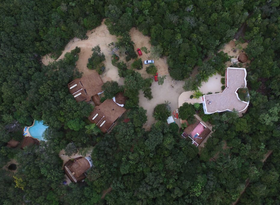 Drone view of the eco-resort Pueblito Selva Chemuyil. La posada building is on the right side
