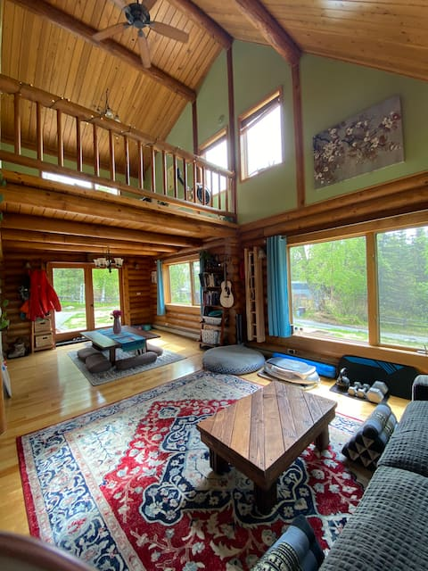 Sunny log home on miles of multi-use trails.