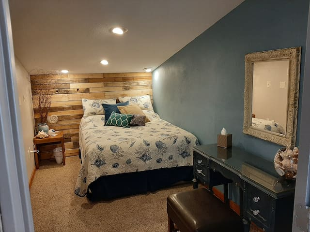 Seaside bedroom.  Dimmable light remote, fan,  and alarm clock with bluetooth/white noise options.