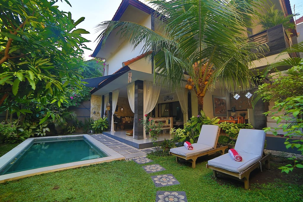 Spacious garden with crystal clean swimming pool is the best place to have a sun bath