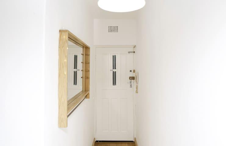 Beautiful oak floors and crisp white walls elegantly welcome you home.