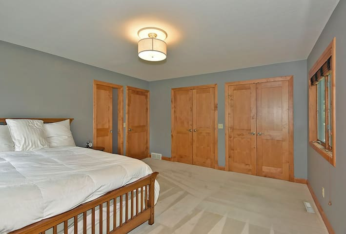 Main Floor Bedroom with Queen and walk thru Master Bath