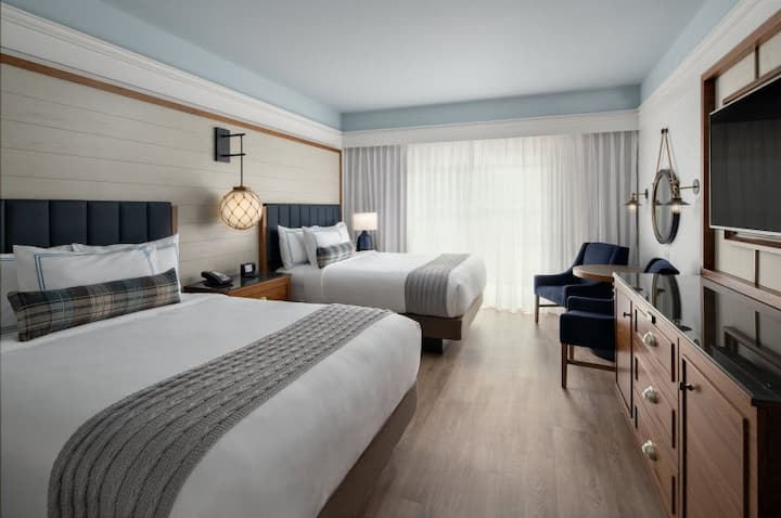 Boutique hotel room with 2 luxurious queen beds