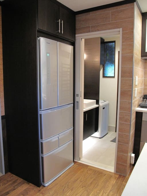 Large fridge and in-suite washing machine.