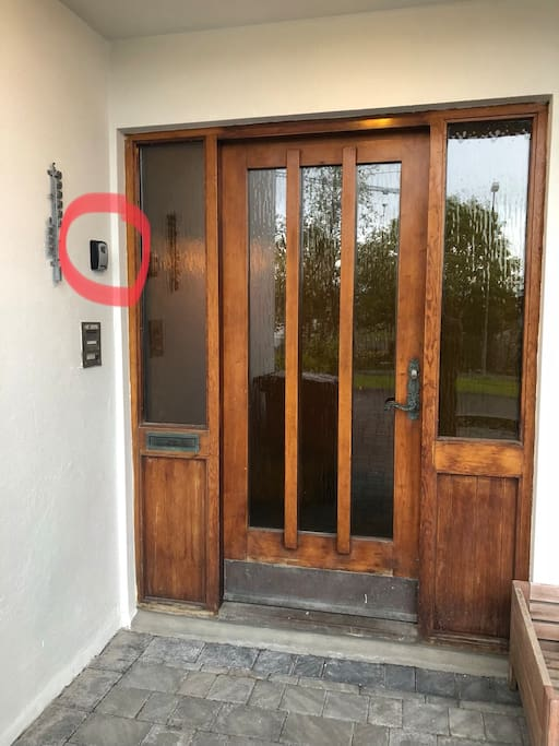 The entrance, keybox in the red circle - the left door