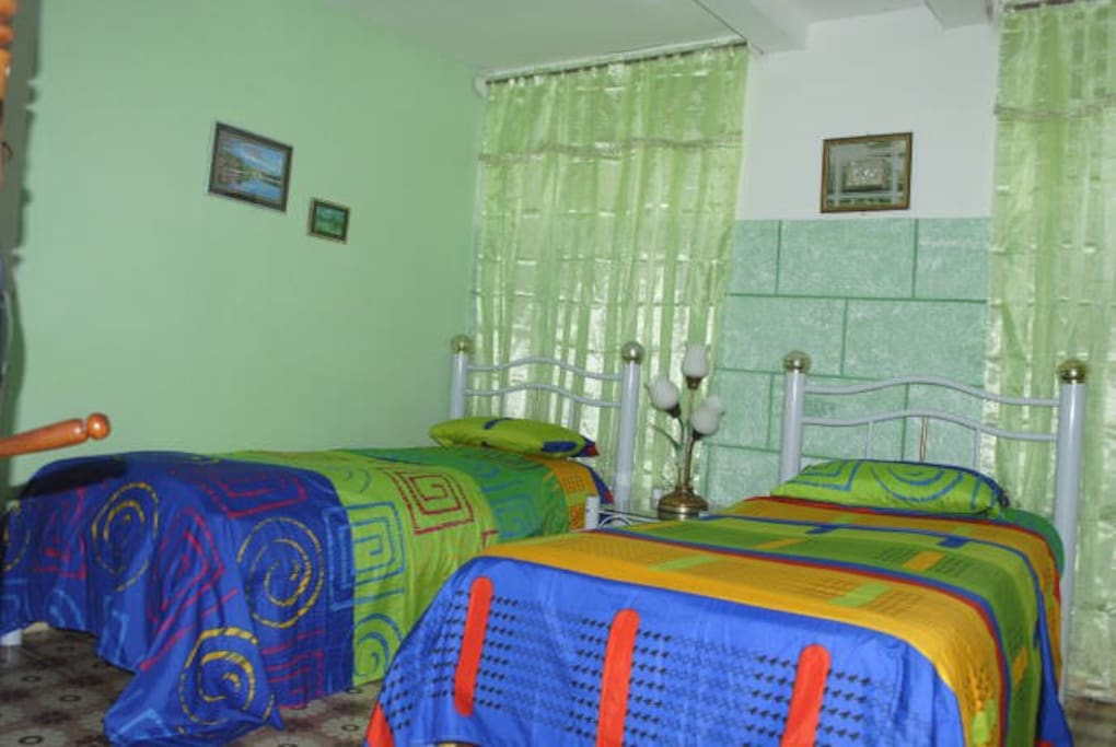 Bedroom 2. Has 2 single beds and a 3rd can be brought in to accommodate a 3rd person.