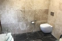 Toilet, vanity and shower space. We are on a septic system, and would ask that guest be mindful of that.