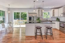 Sunny, open floor plan! (High-top dining table - not shown here - seats  seats 6)