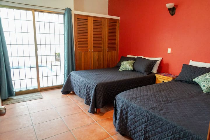 2nd bedroom with 2 full size beds and access to pool.
