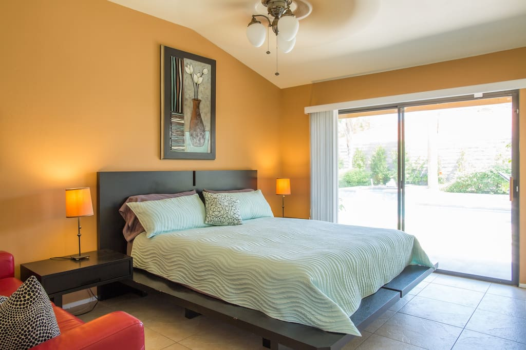 Master Bedroom with cal king and slider to the pool.