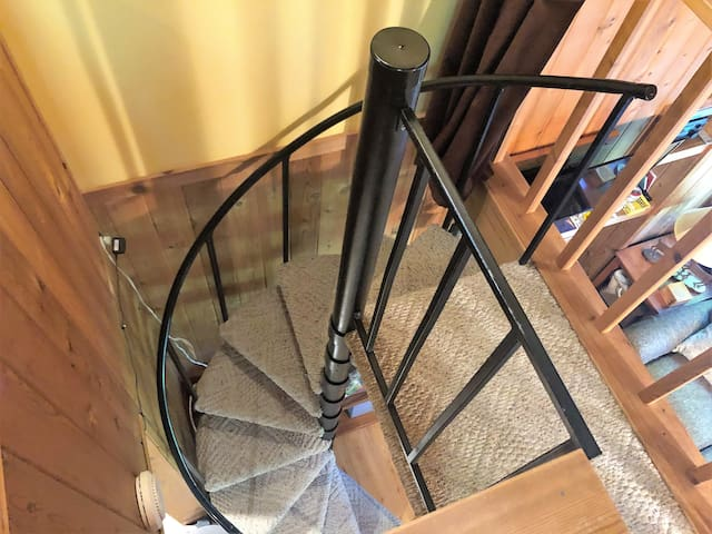 Staircase leading to the loft area with a king size bed.