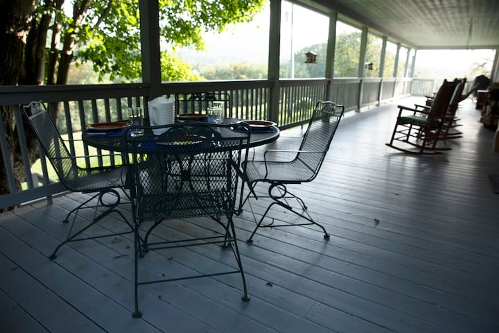 From the big porch, you can view the Blue Ridge Parkway and Green Mountain.   It is a perfect place for outdoor dining, a morning cup of coffee, reading and relaxing in the rocking chairs, bird watching, or enjoying mountain sunrises and sunsets.