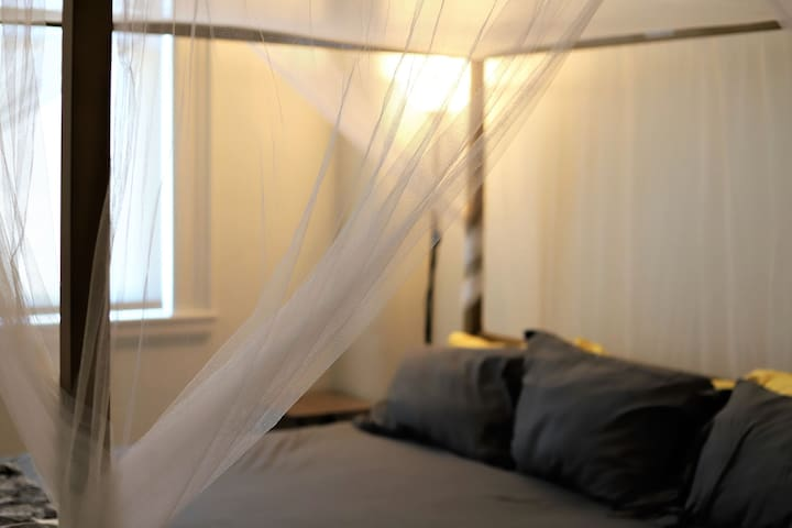 Enjoy our luxurious KING sized bed with canopy drapes