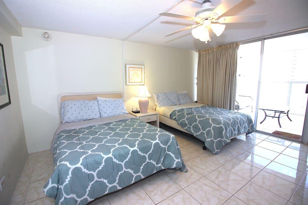 Cool Ceiling fan over 2 queen beds