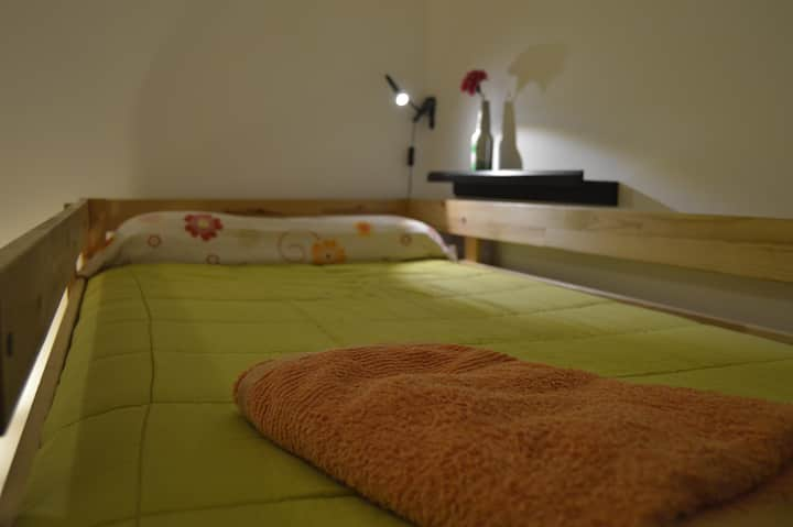 Bed in shared female room next to the beach