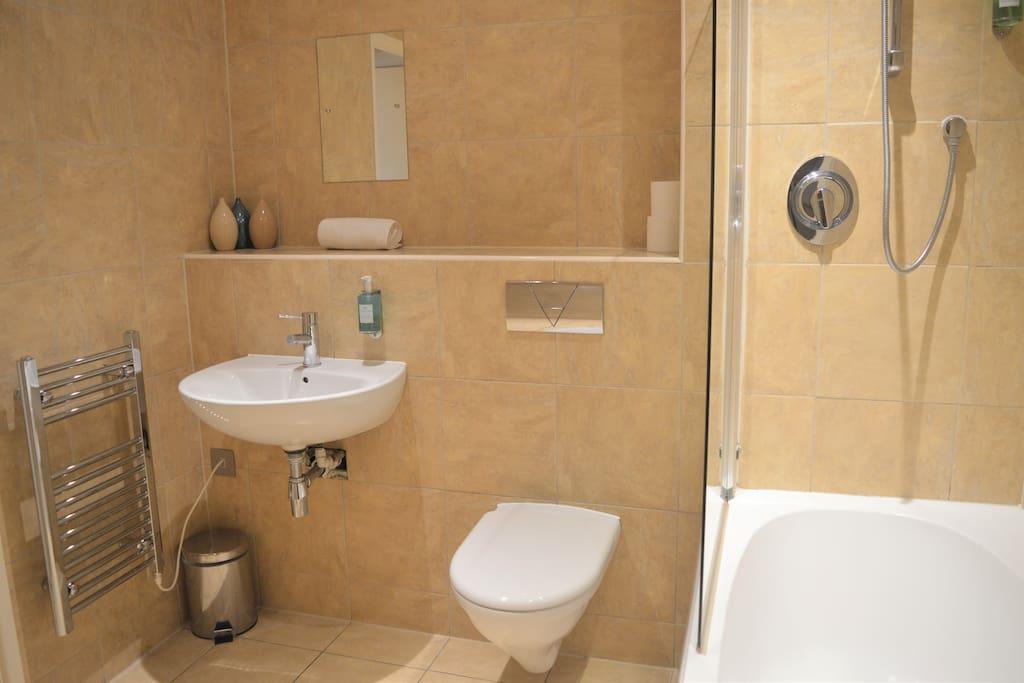 Spacious Bathroom with Shower over Bath