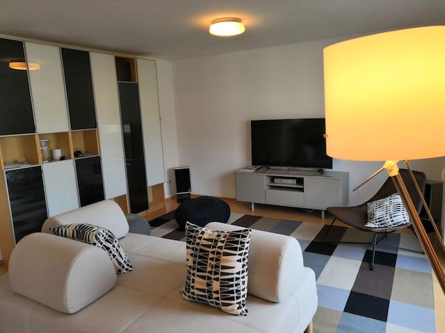 Bright and modern living room. Here you can enjoy watching Netflix, listening to music or simply relax and chill out.