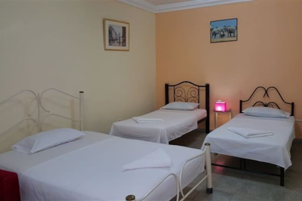 A double bed and two single beds in the bedroom