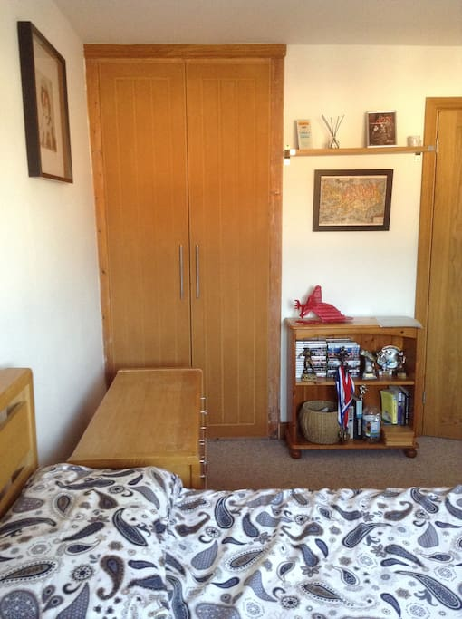 Large wardrobe with lots of hanging space.