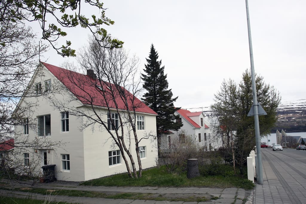House seen from street. A walk down the hill and you are downtown. You can see Akureyri church on far right.