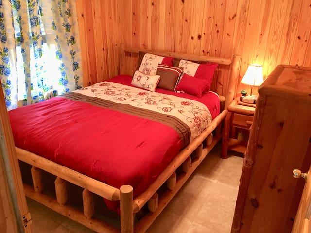 Log bed in master bedroom.