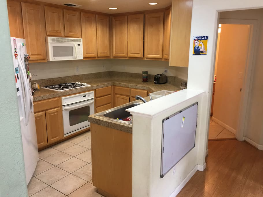 Kitchen with stove, oven and microwave.