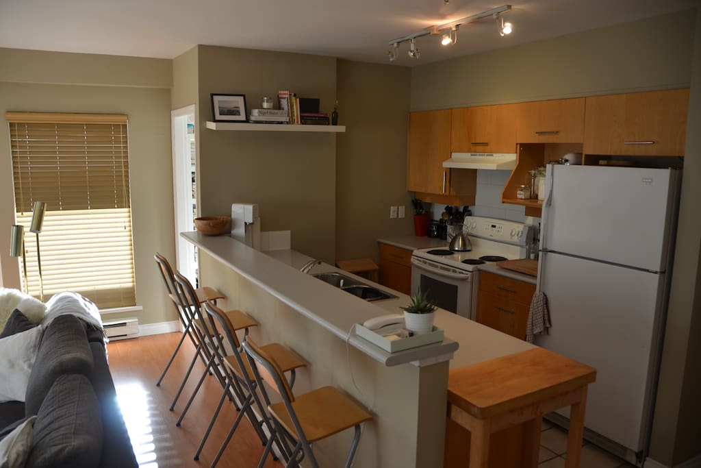Exposed, fully stoked kitchen.  Great for entertaining.