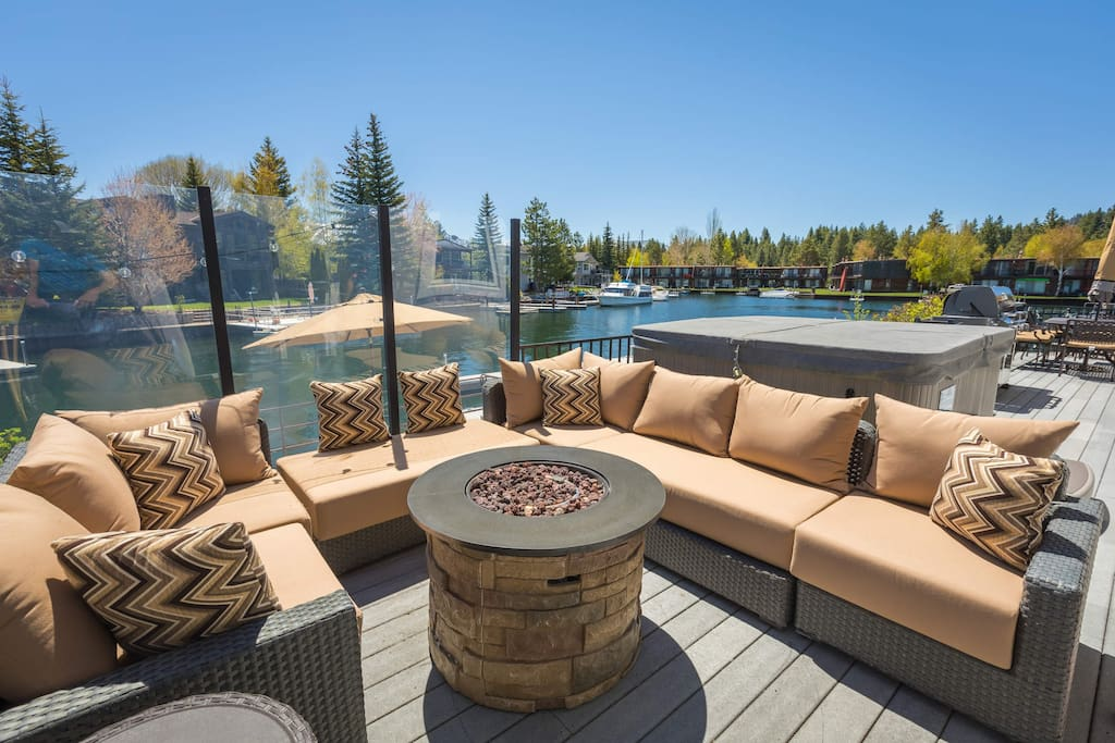 Gather round the fire pit, as there's plenty of comfortable seating for everyone.