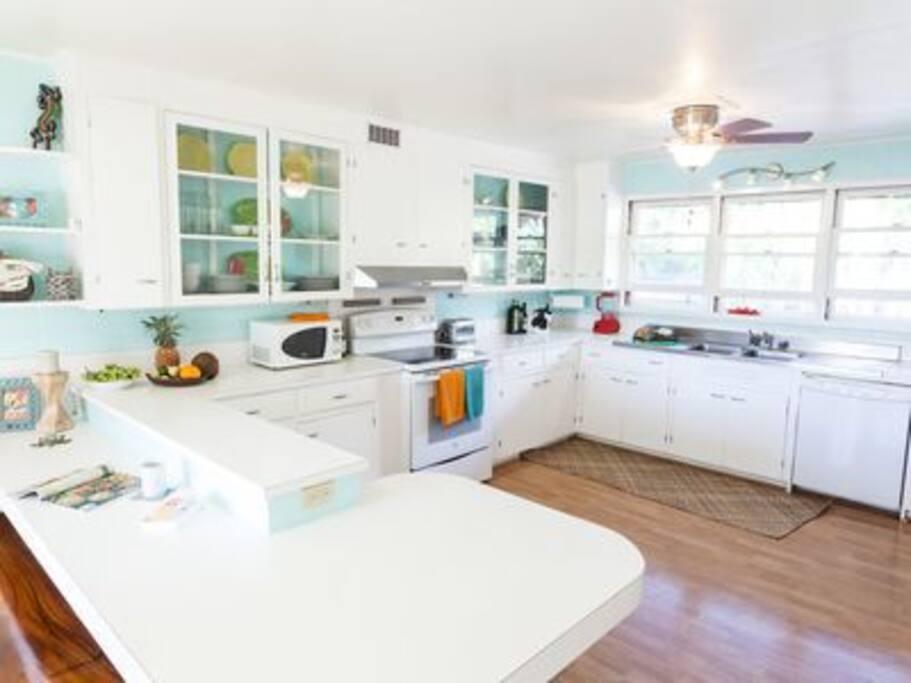 Bright kitchen opens to lanai via french doors