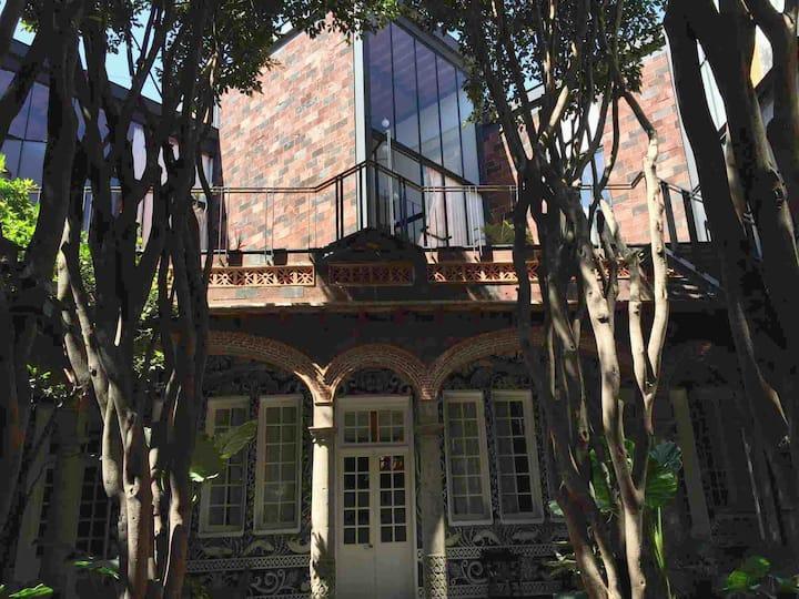 12 habitaciones en una bella casa con jardines